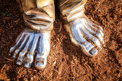 Bronze Feet. The feet of a bronze statue, showing he is planted in the ground Stock Photo