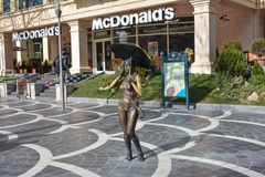Bronze figure of the girl with an umbrella on the street in Baku Stock Images