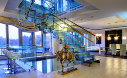 Bronze figure of jockey in interior drawing room maisonette Royalty Free Stock Images