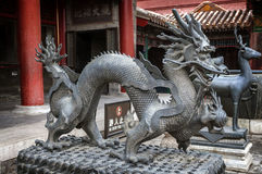 Bronze figures of a dragon and the deer - symbols of longevity a Royalty Free Stock Photography