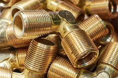 Bronze fittings for pipes. Bronze. Metallic threaded components Stock Photos