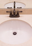 Bronze Fixtures on Marble Sink Royalty Free Stock Images