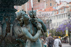 Bronze fountain at Rossio square in Lisbon Stock Images