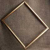 Bronze frame on grunge textile background Royalty Free Stock Image