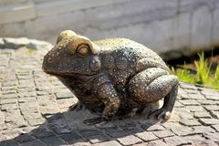 Bronze frog, park landscape decoration,  side view Royalty Free Stock Photo