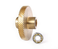 Bronze gear and ball bearing. On a white background Stock Image