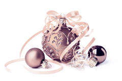 Bronze glass Christmas baubles on white Stock Image