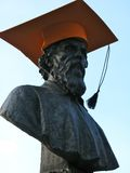 Bronze Graduate. A bronze bust with a graduate hat on it. Obviously a joke from students. Can also be seem as a criticism of modern education methods Stock Photo
