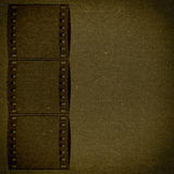 Bronze grunge textured paper with film flame. Background texture for your message Stock Images