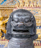 Bronze guardian lion in the grand royal Buddhism temple - Wat Ph Royalty Free Stock Photos