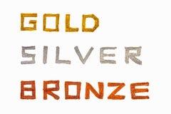bronze guldsilver Arkivfoto