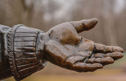 Bronze hand Stock Images