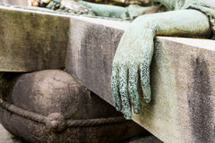 Bronze hand of a statue Stock Images