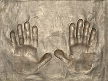 Bronze hands impression. Left and right hand impressions in bronze Royalty Free Stock Image