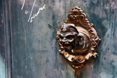 Bronze head. On one of house in Venice. Italy Royalty Free Stock Photography