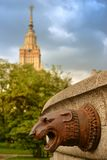 Bronze head of a lion on the old fountain. Bronze head of a lion, decorated with old fountain in the Park near Moscow State University Stock Image