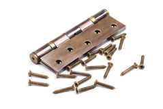 Bronze hinge and screws isolation on a white background stock photography