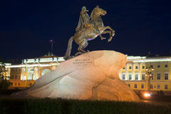 Bronze Horseman against the building of the Constitutional Court of the summer night. St. Petersburg Stock Photo