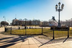 Bronze Horseman is equestrian statue of Peter Great in Senate Square, Admiralty building and street lamp with shadow in Saint stock image