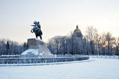 Bronze horseman monument and St. Isaac's Cathedral on winter mor Stock Images