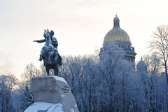 Bronze horseman monument and St. Isaac's Cathedral on winter mor Royalty Free Stock Image
