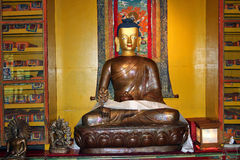 Bronze Image Of Lord Gautama Buddha, Norbulingka Institute. Bronze Image of Lord Gautama Buddha, set among other carvings and artifacts, at the Norbulingka Stock Images