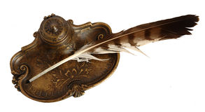 Bronze inkpot with feather Stock Photos
