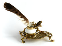 Bronze inkpot with feather Royalty Free Stock Images