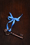 Bronze key with blue ribbon Stock Images