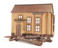 Bronze key and house model Stock Photo