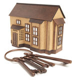 Bronze key and house model Royalty Free Stock Photography