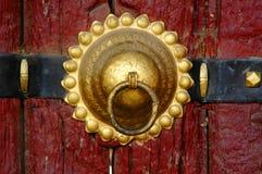 The bronze knocker. On a tibetan Temple wood door Stock Images
