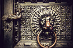 Bronze knocker with lion head Stock Image