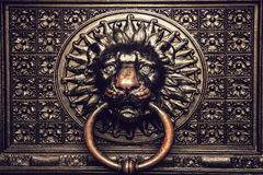 Bronze knocker with lion head Royalty Free Stock Image
