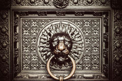 Bronze knocker with lion head. A bronze knocker with a lion head at the gate of the Cologne Cathedral Royalty Free Stock Photography