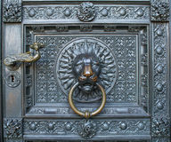 A bronze knocker with a lion head at the gate of the Cologne Cathedral Royalty Free Stock Images