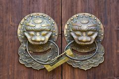 Bronze knocker and lock Royalty Free Stock Photography