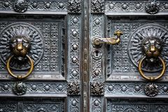 The bronze knocker in the shape of a lion head from the gate of the Cologne Cathedral in Germany Stock Image