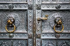 Bronze knocker in the shape of a lion head from the gate of the Cologne Cathedral, Germany Royalty Free Stock Photos