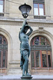 Bronze lamppost shaped as antique caryatide near Palais Garnier, the Paris Opera House in Paris, France Royalty Free Stock Photo