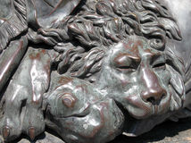 Bronze lion. Bas-relief of the bronze lion Royalty Free Stock Image