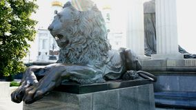 Bronze lion on the pedestal. Bronze lion on the background of the temple stock video footage