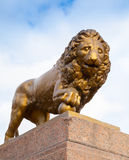 Bronze lion with ball, monument on stone base Royalty Free Stock Photos