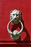 Bronze lion door knocker. On red door in Mdina, Malta Royalty Free Stock Image