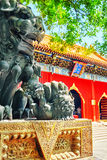 Bronze lion at the entrance to beautiful Yonghegong Lama Temple. Stock Photography