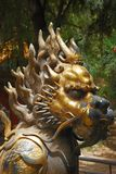 Bronze lion in Forbidden City garden Stock Photo