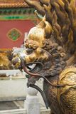 Bronze lion in front of the Hall of Supreme Harmony in Beijing F. Gilded lion statue, Forbidden City, Beijingin Beijing Forbidden City Royalty Free Stock Images