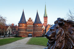 Bronze lion in front of the Holstentor in Luebeck, medieval city Royalty Free Stock Image