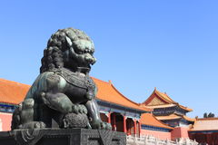 Bronze lion in front of palace Stock Image