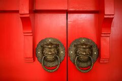 Bronze lion head with ring in its mouth door knob stock photo